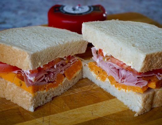 Snowdonia Red Devil Cheese, Ham and Tomato Sandwich - Cut in half