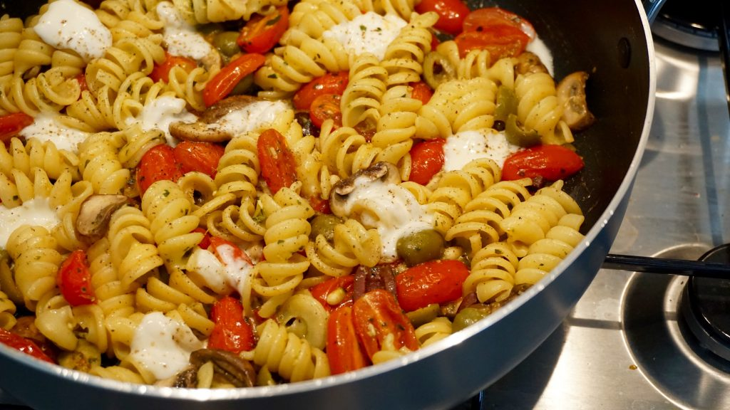 Mozzarella Olives and Tomatoes Pasta in a Pan Close Up