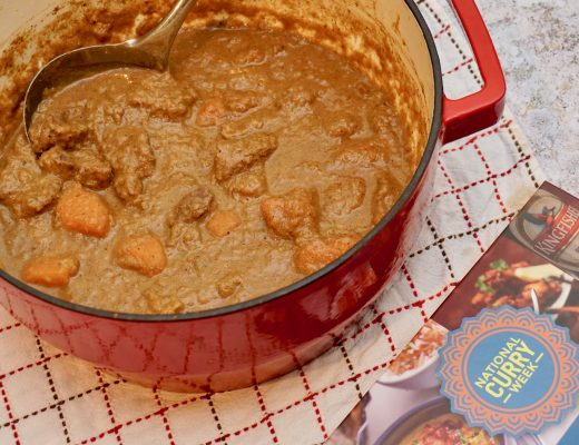 Sweet-Potato-and-Lamb-Curry-in-dish-next-to-national-curry-week-recipe-book